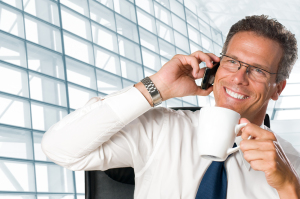 Mature businessman taking a break with a cup of coffee in his mo