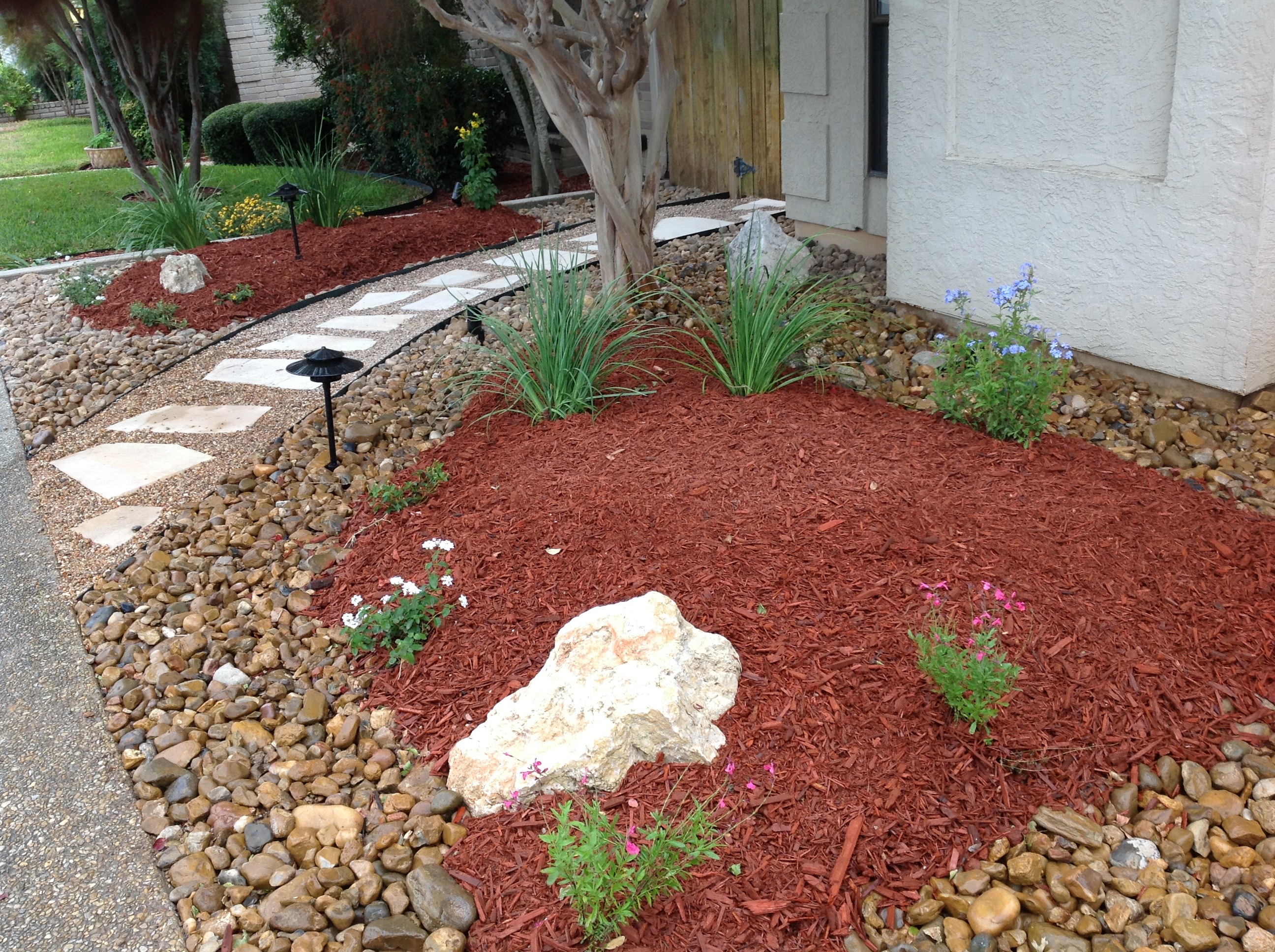 Low maintenance landscaping and water conservation for Landscaping rocks and plants