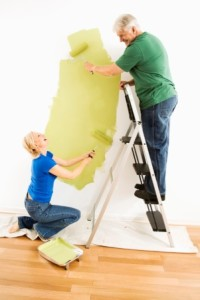 happy-couple-painting-ladder