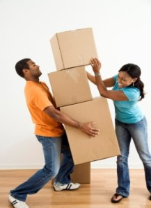 happy-couple-moving-boxes